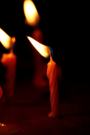 Burning candles with candle light in the dark Stock Photo