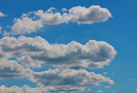 Fantastic soft white clouds against blue sky on background Stock Photo