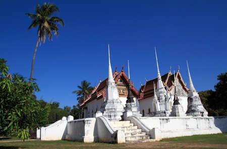 Wat Uposatharam at noon under blue sky Background Stock Photo