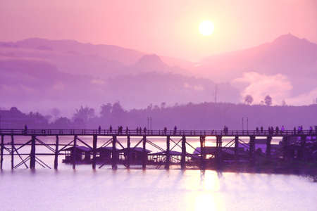 The Sunrise, morning mistof the longest wood bridge Mon bridge at Sangkhla Buri, Kanchanaburi Province, Thailand