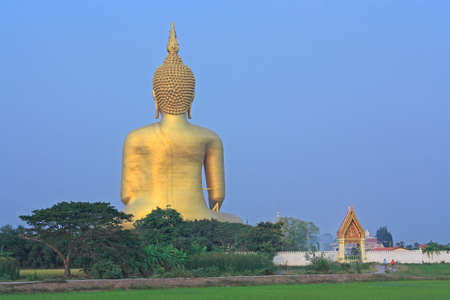 Wat Muang with head Buddha statue in Thailand Stock Photo