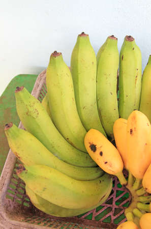 Banana ripen in groups on the table background Stock Photo
