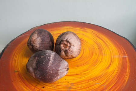 Coconut old on the table.