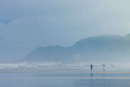 Beach and morning mist,thailand Stock Photo