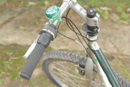 Detail of a bicycle bell attached to bicycle handlebar