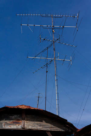 televisions antennas  on blue sky background