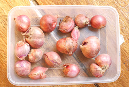 shallots fresh purple on the wood table background Stock Photo
