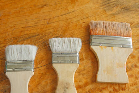paint brush on wooden table background