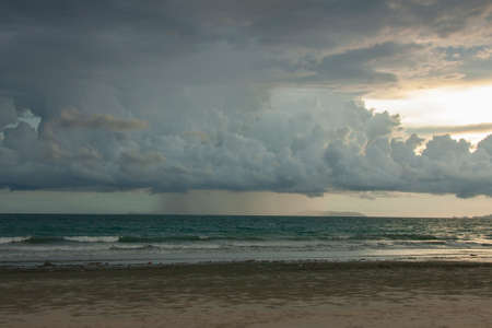 Summer on the beach. Sandy seashore during sunset. Фото со стока