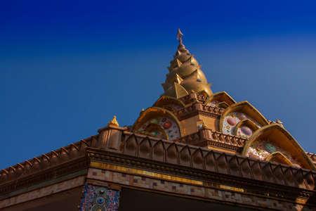 stupa at noon under blue sky Background Stock Photo