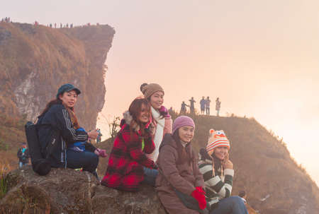 6 FEBRUARY 2014,Chiang Rai,Thailand:Tourists group watch the morning light at the Phu Chi Fa viewpoint, Chiang Rai, Thailand