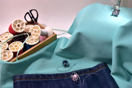 singlet: Sewing machine blue lady singlet,Jeans and equipment.