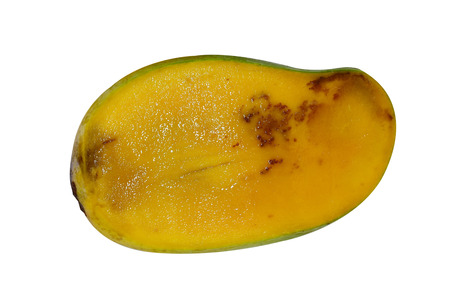 Mango cut crosswise rotten due to poor storage, isolated on white background with clipping path. Stock Photo
