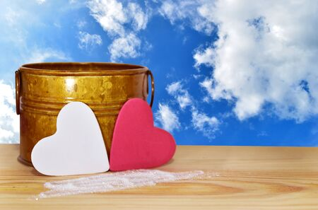 White and red heart placed on a wooden table  , clipping path included to remove the background with ease.