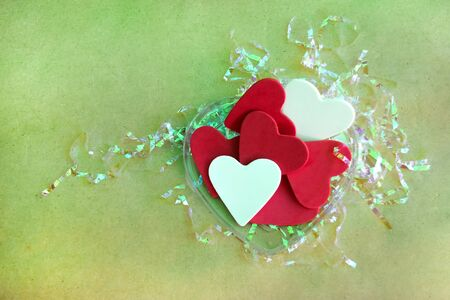 Red hearts and white pattern on brown paper over the top and empty space for text. Stock Photo