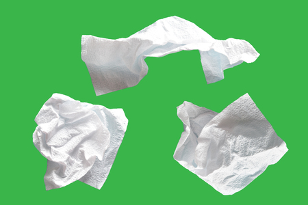 Piece paper tissue white,  isolated on green background with clipping path.