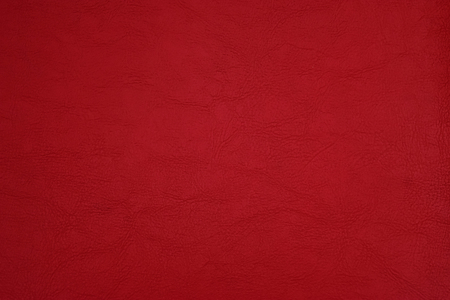 leatherette: Surface of red leatherette texture.