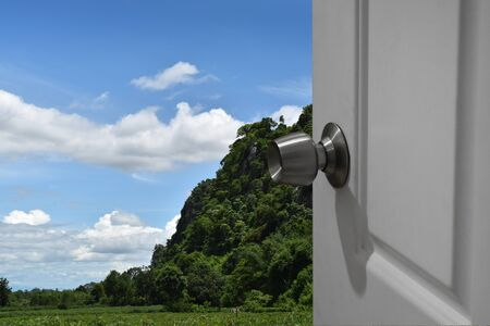 White door open to nature and empty space for text or foreground with clipping path and changing the background Stock Photo