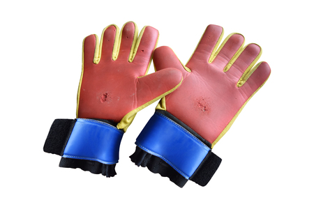 Top view old goalkeeper gloves and dilapidated, isolated on white background with clipping path.