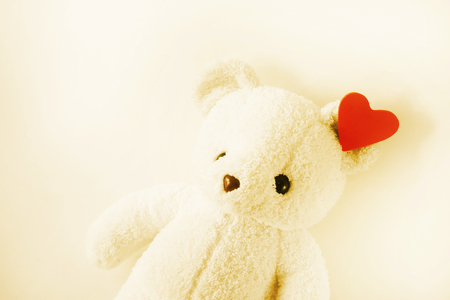 White teddy bear style retro and empty space for text.Day of Love on Valentine's lonely or in the past.