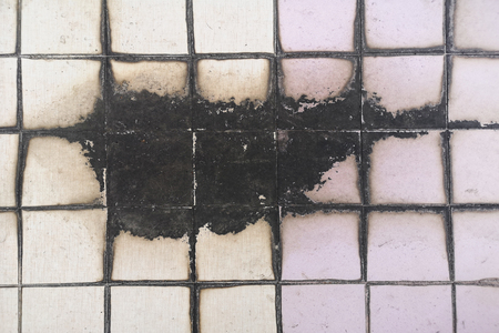 Tiled floor in toilet misuse selection Stains and fungusThe concept of moisture and dirt and empty space for text.