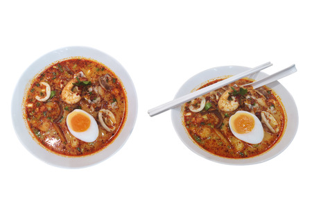 Tom Yum style of thai food with rice stick noodles.