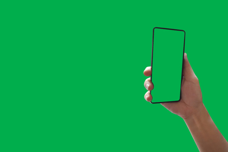 Top View holding hand smartphone with green screen Isolated on background with clipping path.