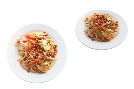Pork sausage salad spicy thai food.Dressing consists of Chili, fish sauce, lemon juice, sugarand add vegetables as you like, such as onions, carrots, nuts. isolated on white background with clipping path . Stock fotó