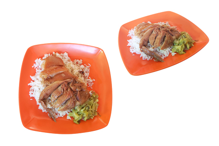 Top and side view,Stewed pork leg on rice in an orange plastic dish, paired with pickled lettuce.isolated on white background with clipping path.Speaking Thailand