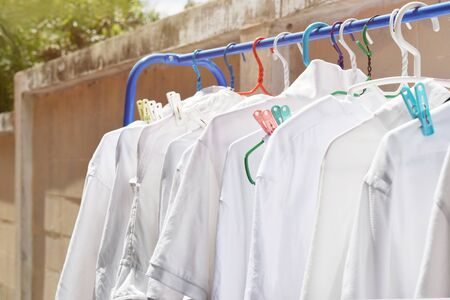 Drying the white shirt in the sun Resulting in damaged fabrics.