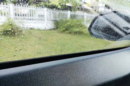View through the sideview mirror ,roadside area On a rainy day, the weather is bad.