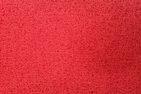 Close-up the red plastic fiber Carpets for collecting dust. View from top See the clear details.