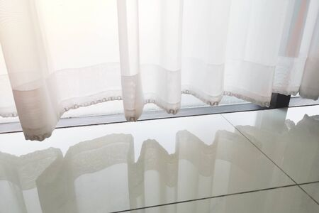 White curtains for window filtering, Chain clasp for weighted fabric seams. Stock fotó