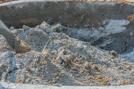 compacted: cement mix concrete is compacted sand. Waiting to be mixed with cement