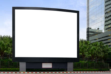 Blank advertising billboard LCD advertisement for adjust your message at modern building in the city with nice sky , mock up selective focus with clipping path. Reklamní fotografie