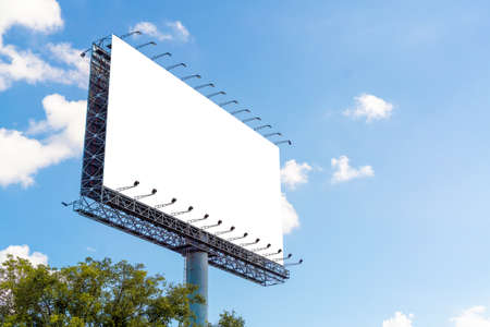 Blank advertising billboard advertisement for adjust your message at city with nice sky , mock up selective focus with clipping path.