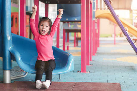 back to school concept, Young asian cute girl or pupil happy at playground in first day of kindergarten school, Selective focus