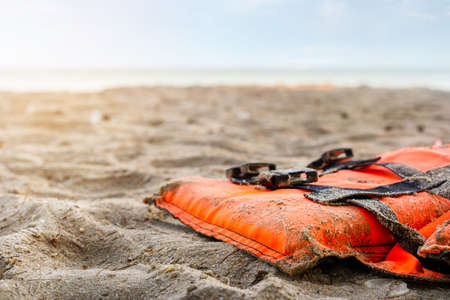 Close up of life jacket on the beach in sunrise, Selective focus. Foto de archivo
