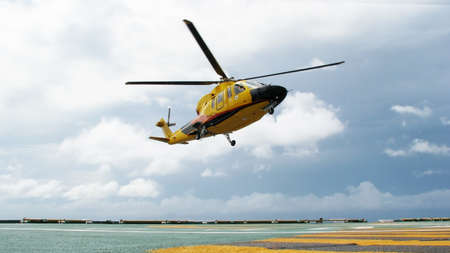 embark: The helicopter landing on at oil platform Stock Photo