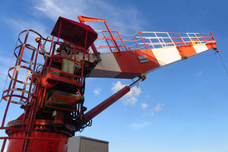 Crane construction on Oil and Rig platform for support heavy cargo. Transfer cargo or basket on work site, Heavy industry, heavy job on the oil and gas platform, Offshore operation on the platform.