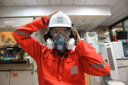 Multi-purpose respirator half mask for toxic gas protection.The man prepare to wear Multi-purpose half mask