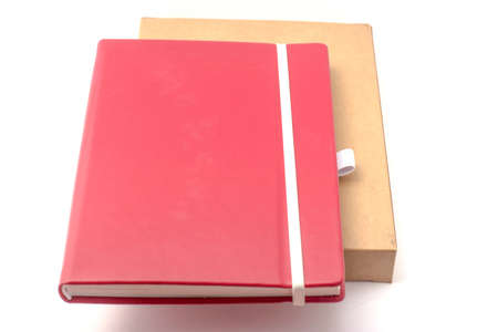 moleskine: red notebook on white background