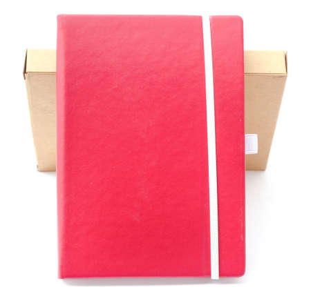 moleskin: red notebook on white background