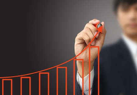 Business man write growth graph photo