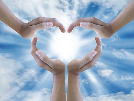 sun sign: four hand make sign heart around the sun  Stock Photo