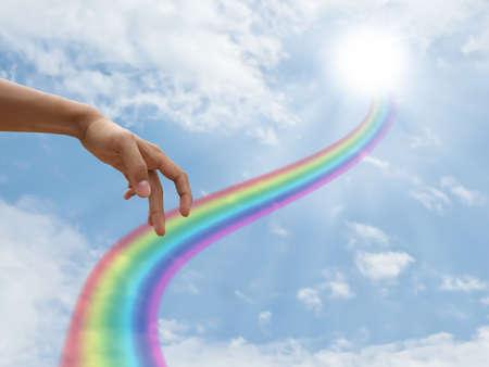 Hand walking on rainbow way photo