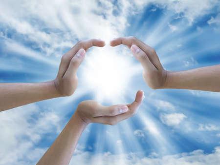 three hand holding the sun Stock Photo