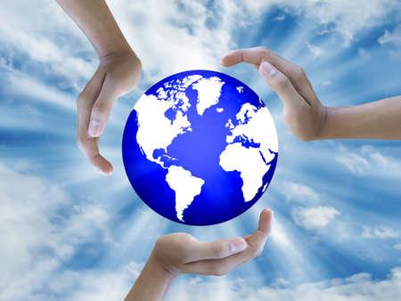 Three hand holding the world