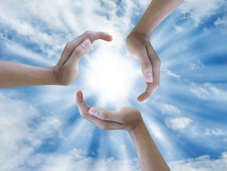 create idea: three hand holding the sun Stock Photo