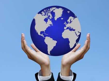 Photo: business hand holding world Stock Photo